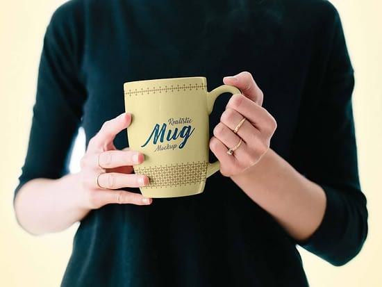 Free Hand Holding Metal Mug Mockup